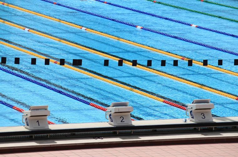 #EngineeringTheOlympics: Tolerance in Olympic Swimming results in more ties