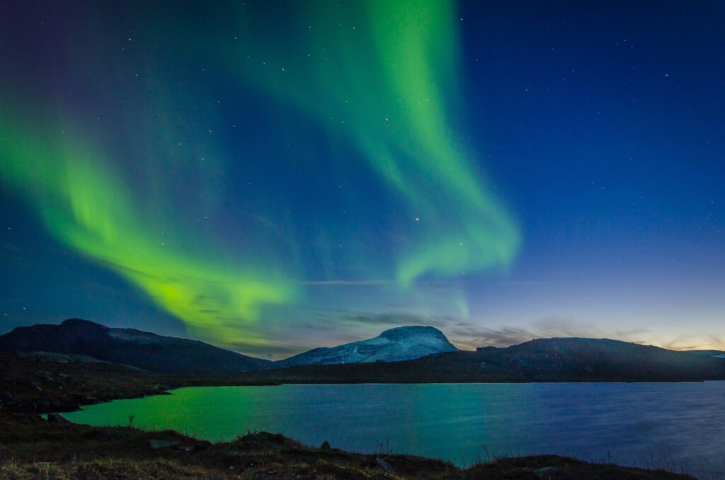 aurora borealis over body of water during nighttime